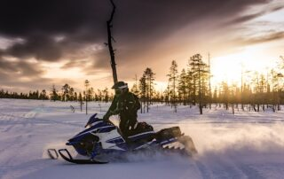 Riding a snowmobile in winter