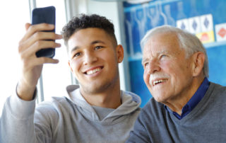young man and older male taking a selfie